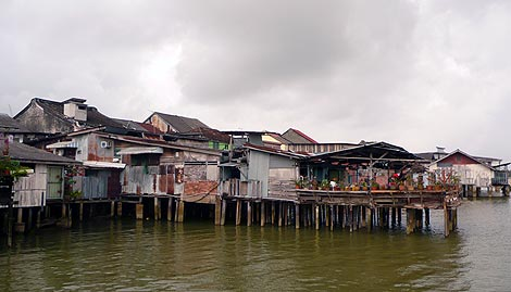 shophouses extending into the river