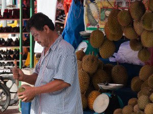 {Malaysian Moments,  man selling Durian