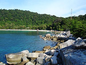 Pulau Perhentian Besar, The Big (=besar) Island. The slightly bigger island offers more expensive resort style accommodation. For family travellers or those who like it more quiet and have an extra Ringgit to spend.
