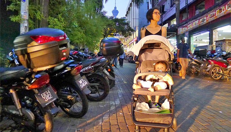pushing the stroller in KL